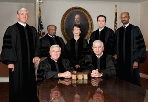 Back Row L-R David Nahmias, Robert Benham, Carol Hunstein, Keith Blackwell and Harold Melton. Front Row L-R Presiding Justice Harris Hines and Chief Justice Hugh Thompson. Handout Photo 7-14-2014